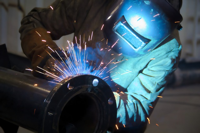 A welder working in an industrial plant.